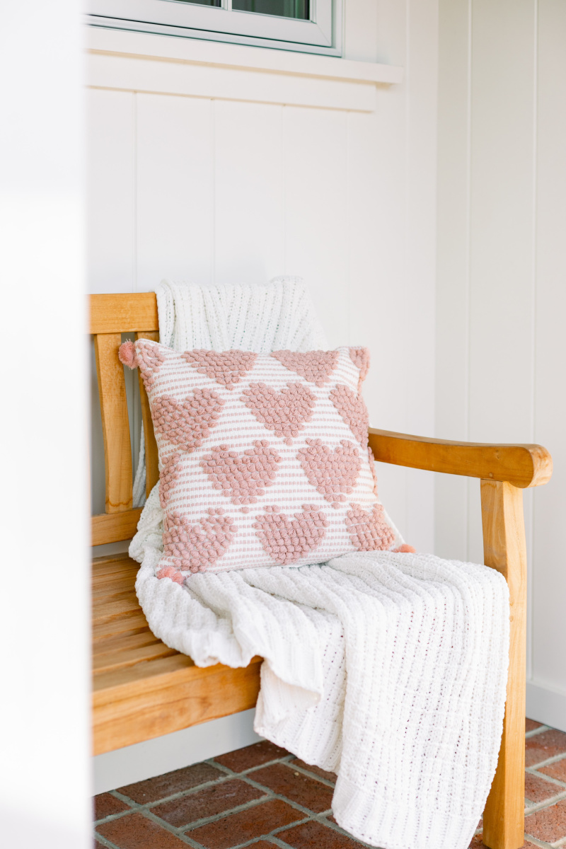 Teak Bench with throw and heart pillow