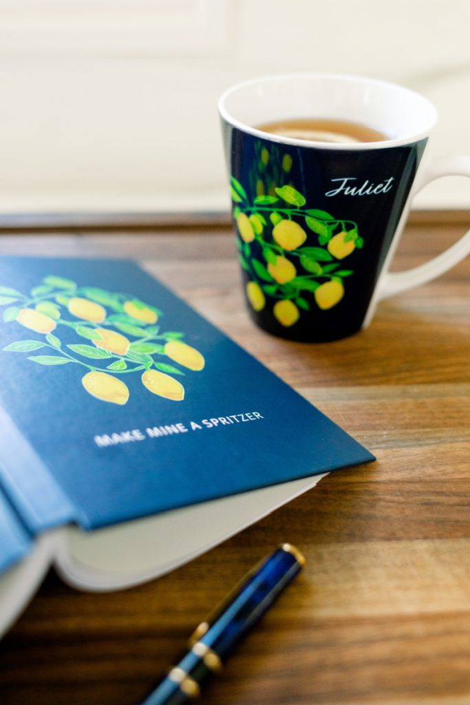 Citrus themed notebook and coffee cup