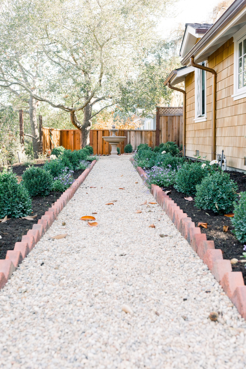 Garden gravel path with brick border and boxwoods