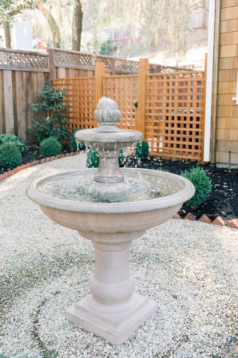 Garden fountain and lattice fence and gate
