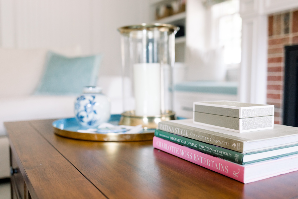 Coffee table vignette, books, candle, tray