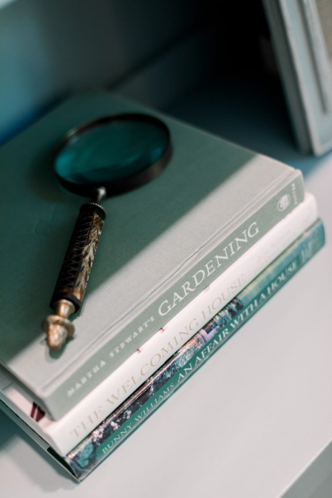 Coffee Table Books and magnifying glass