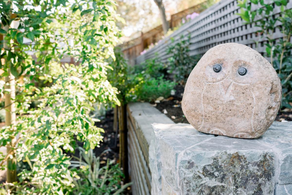 Stone Owl on Garden Wall