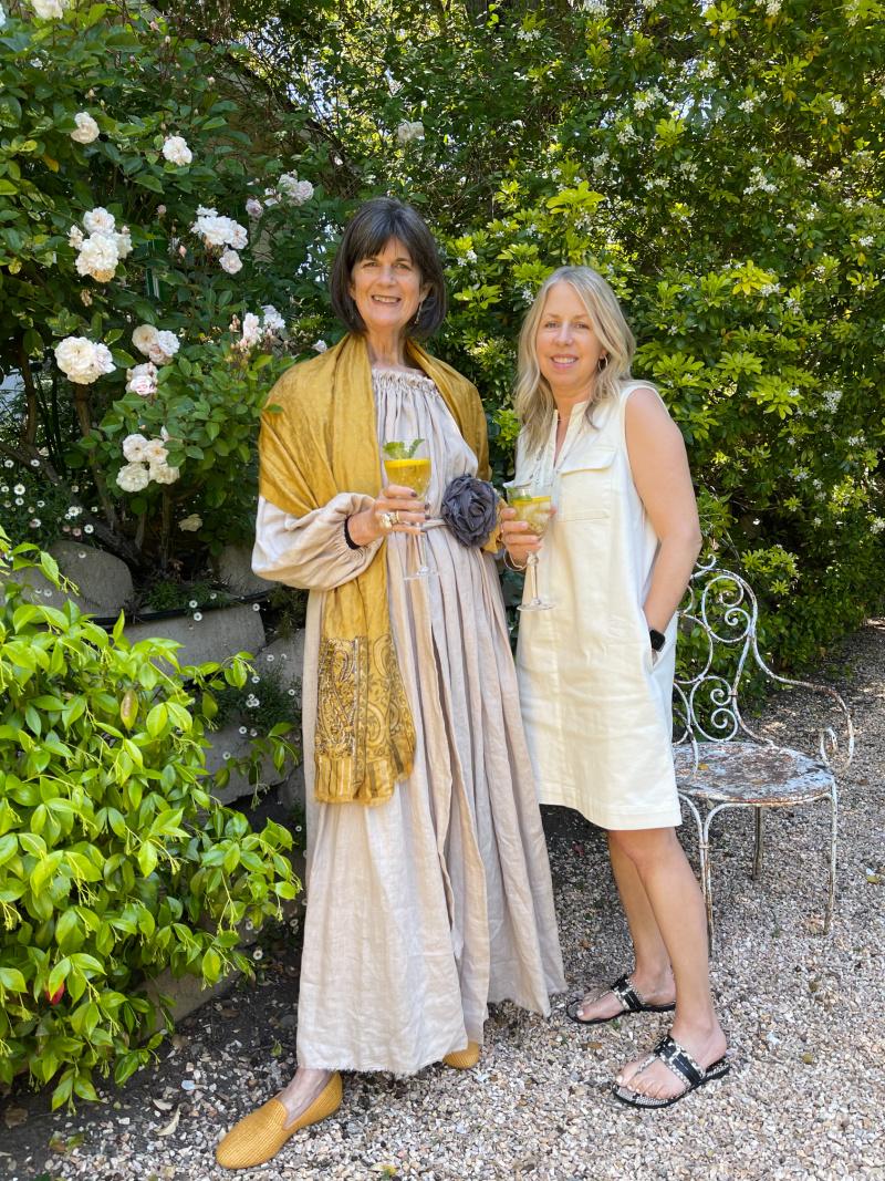 Women in garden sipping tea