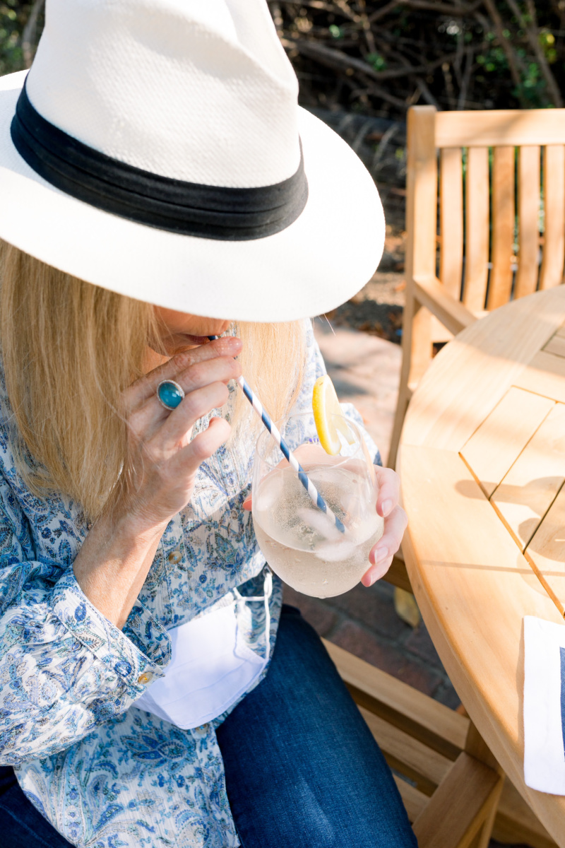 Woman sipping a white wine spritzer