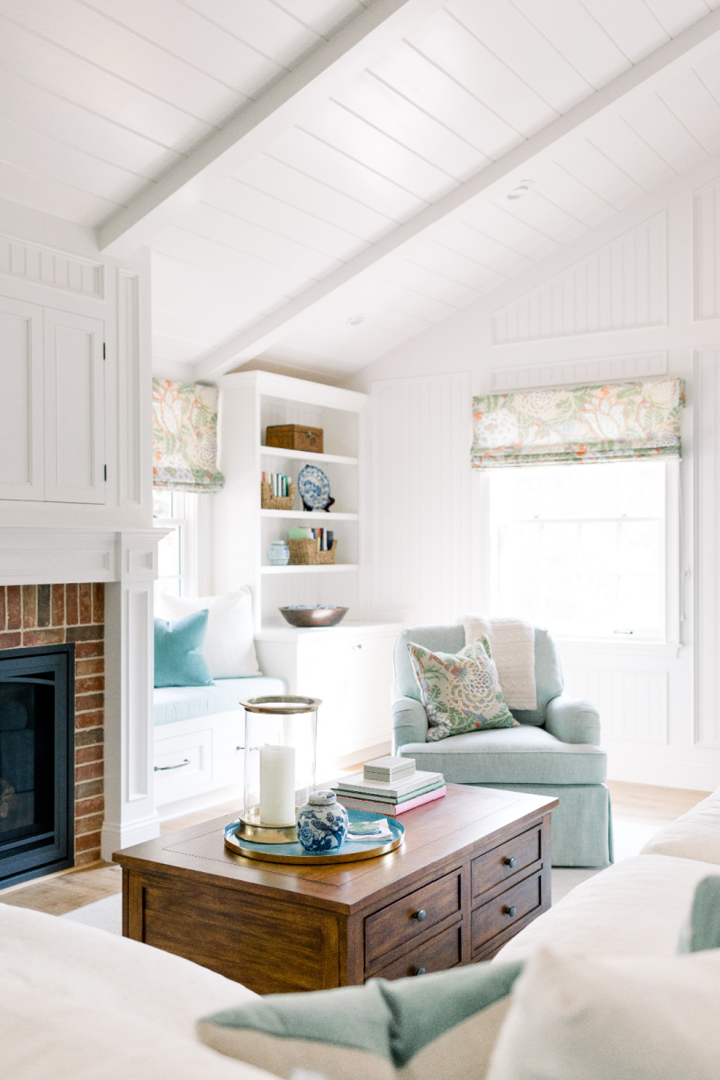 Family room fireplace, swivel chairs and built in shelves