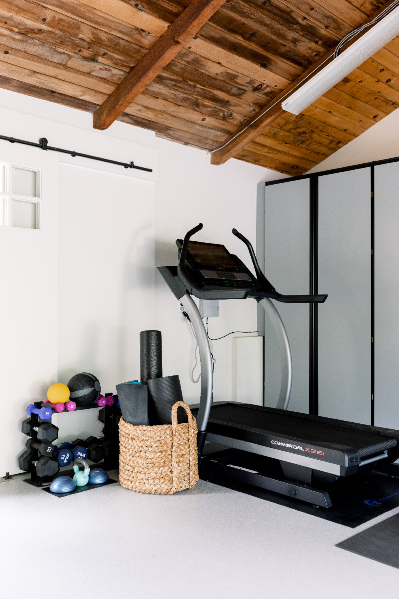 Treadmill and weights in garage gym