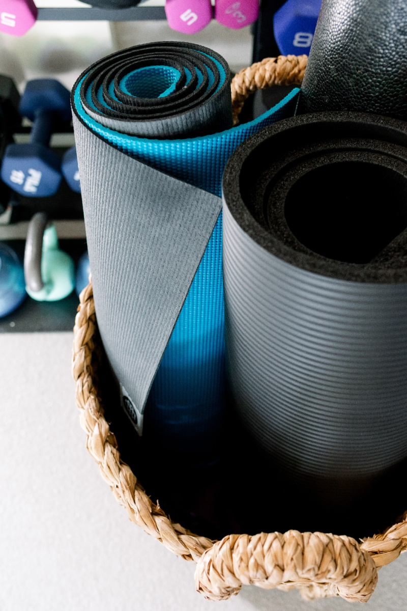 Yoga Mat in basket and weight rack