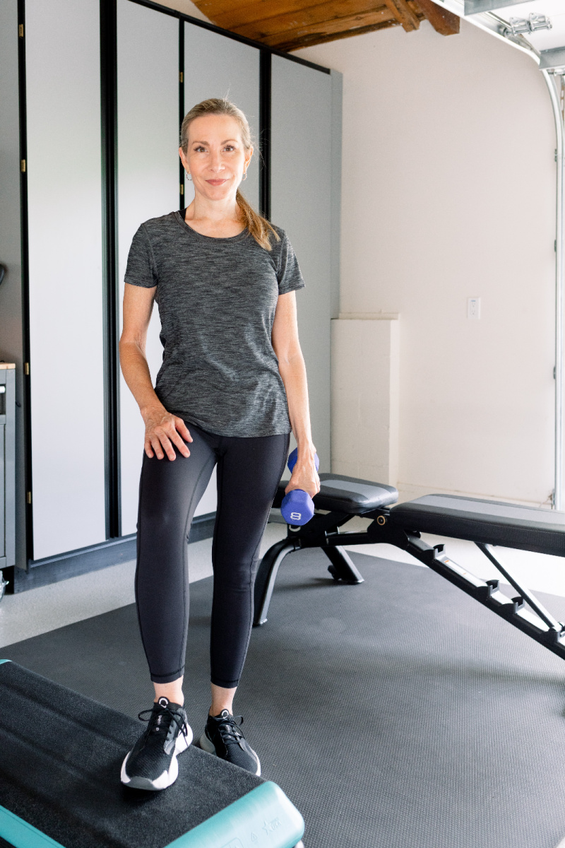 Woman in garage gym with workout step