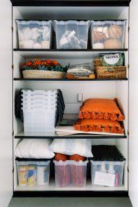Fall decor on garage storage shelves