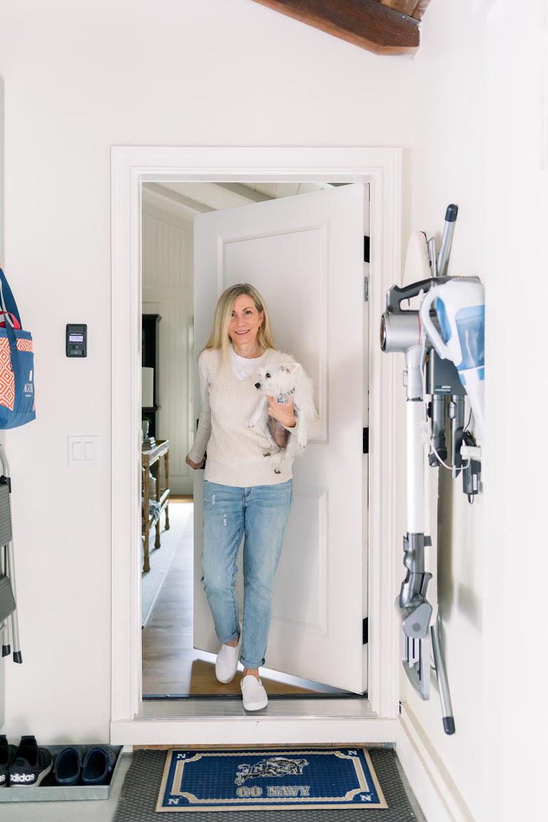Woman and dog entering garage