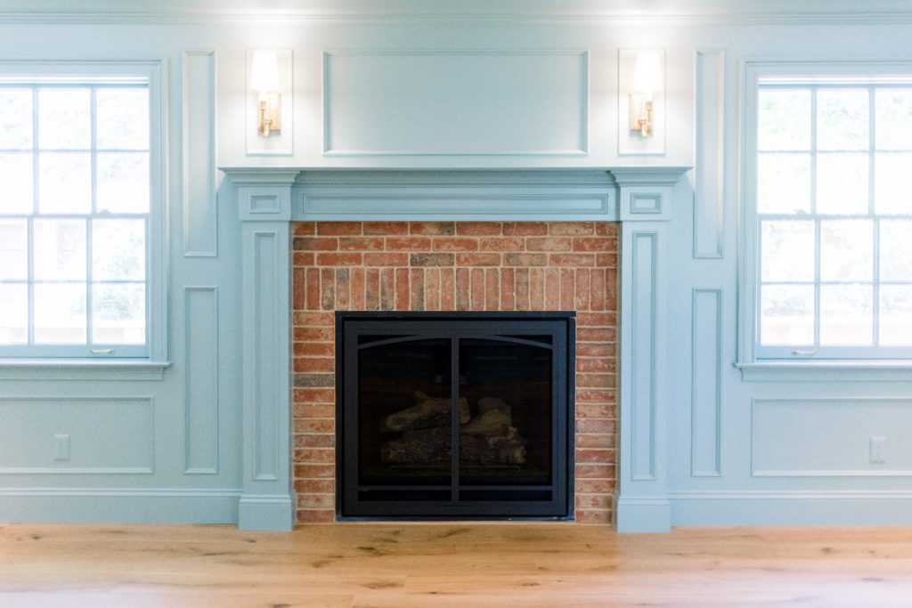 Home Library Fireplace and Sconces