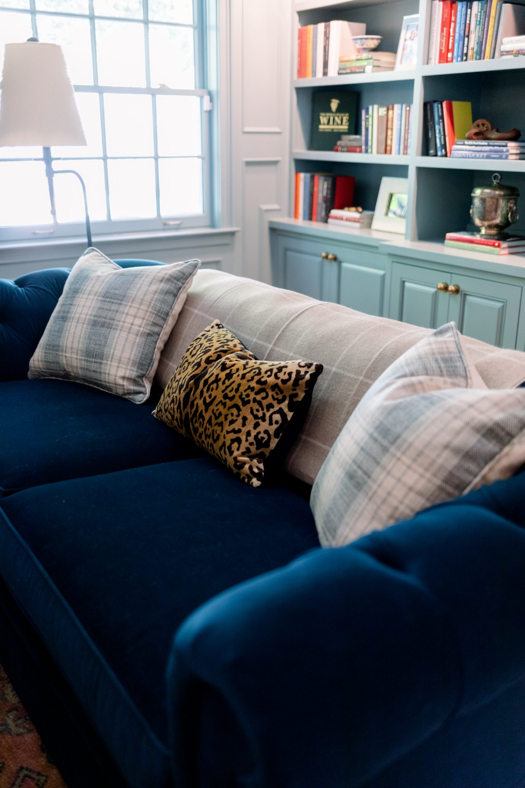 Blue Velvet Sofa with Plaid and Leopard Print pillows