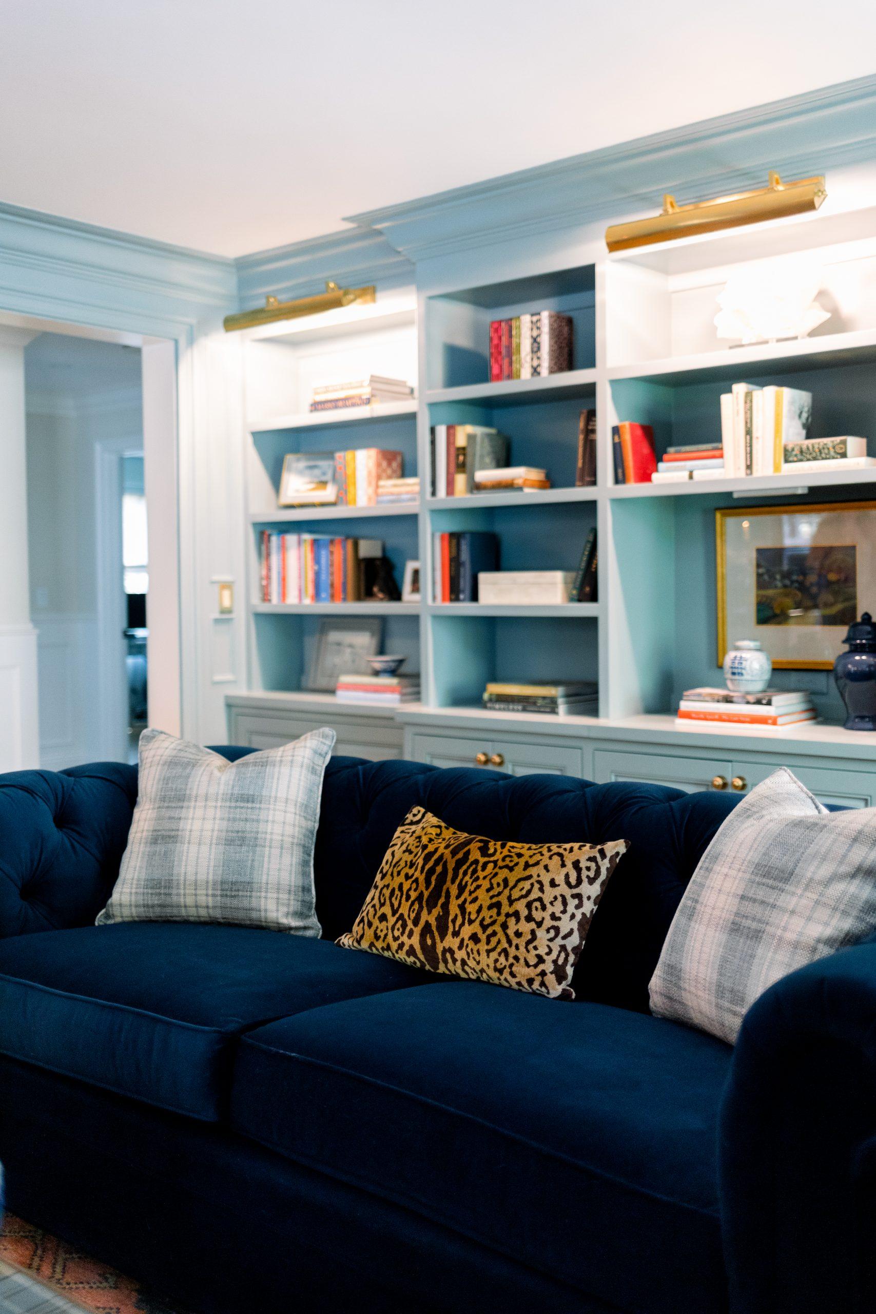 Blue velvet sofa and book cases