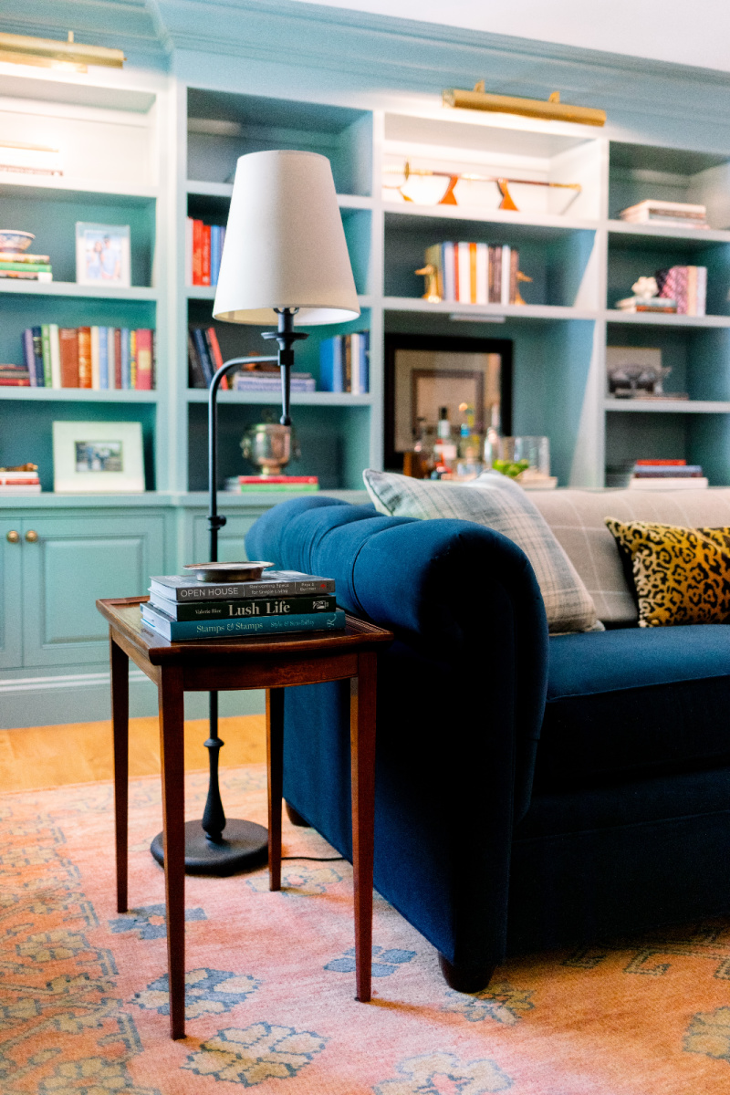 Blue velvet sofa and side table and lamp
