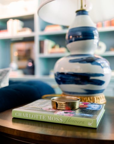 Blue and white lamp on side table with book