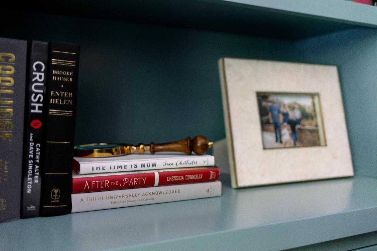 Books and photograph on shelf