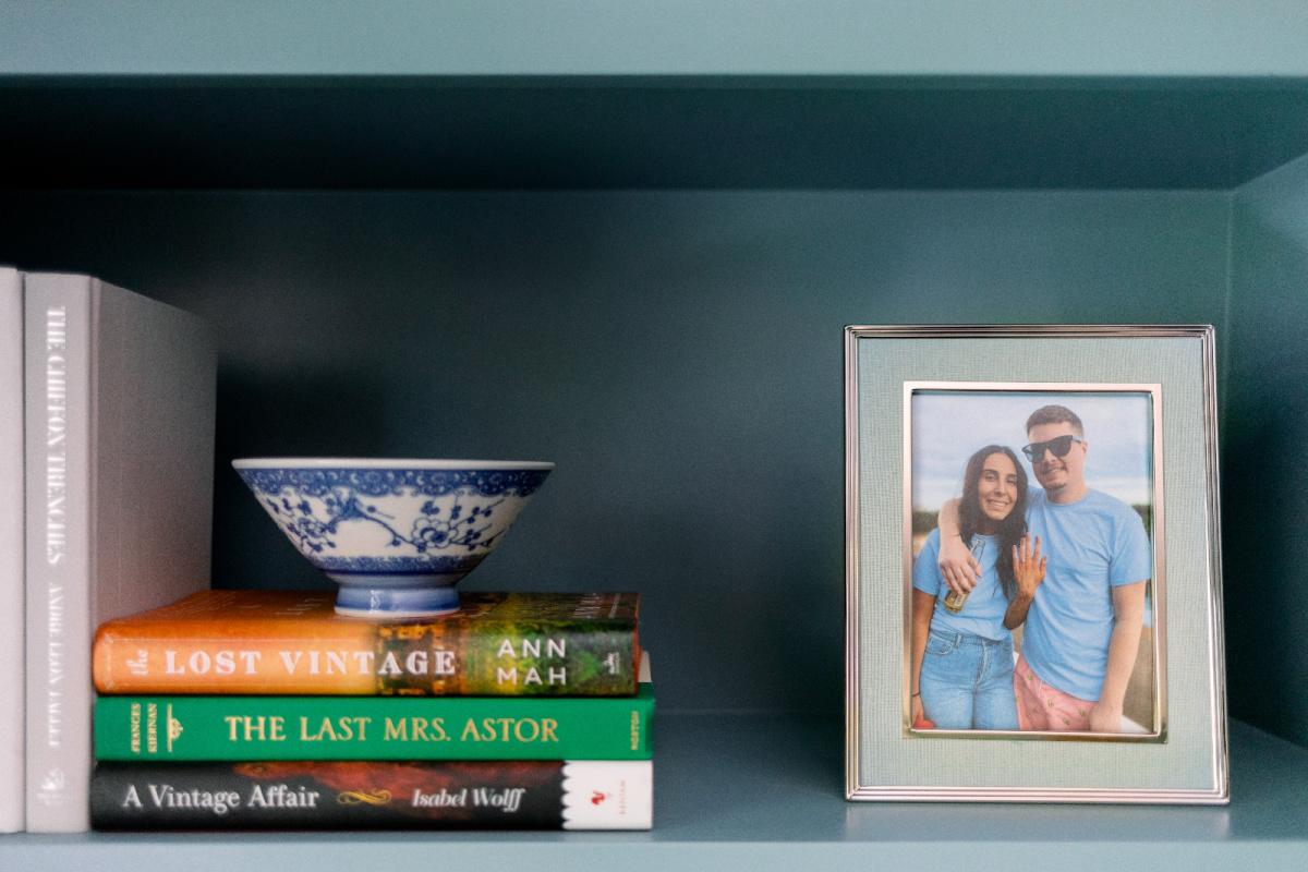 Books and photo on bookshelf
