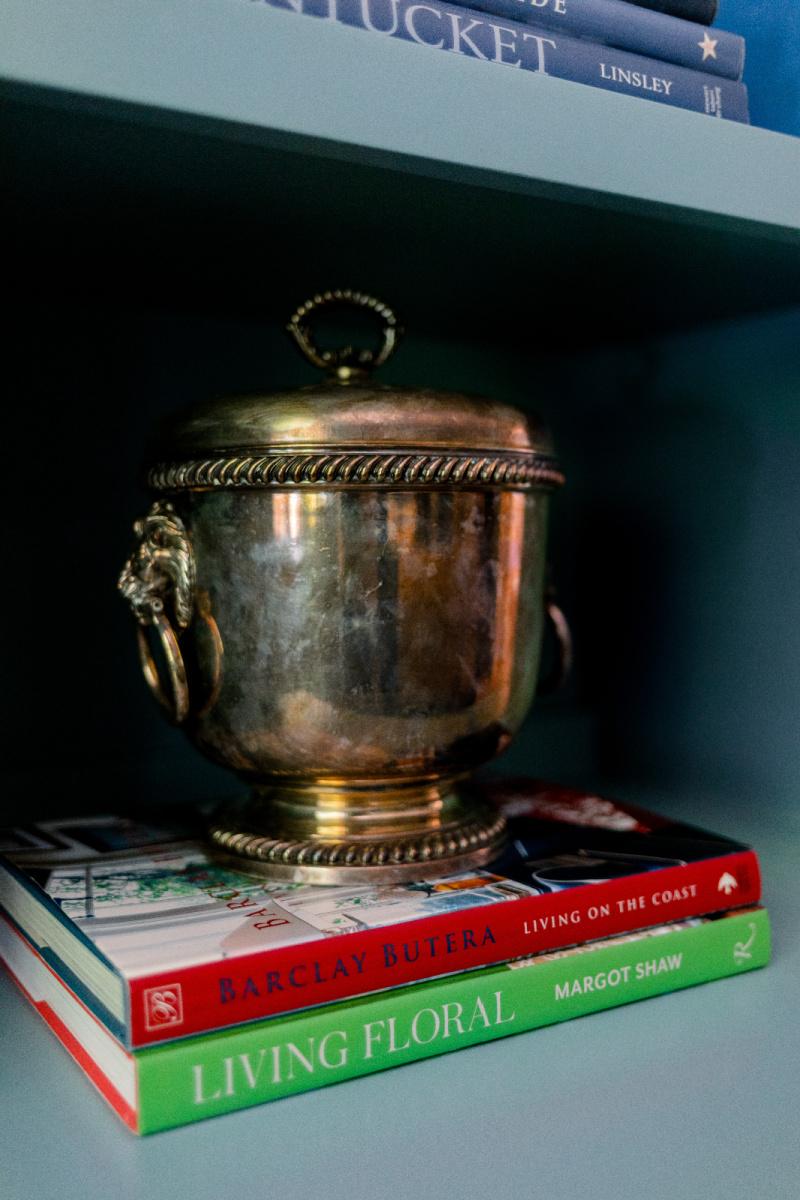 Silver ice bucket sitting on books