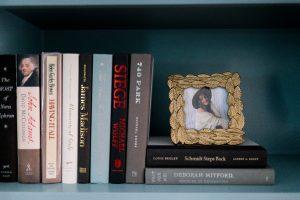 Books and photos on shelf