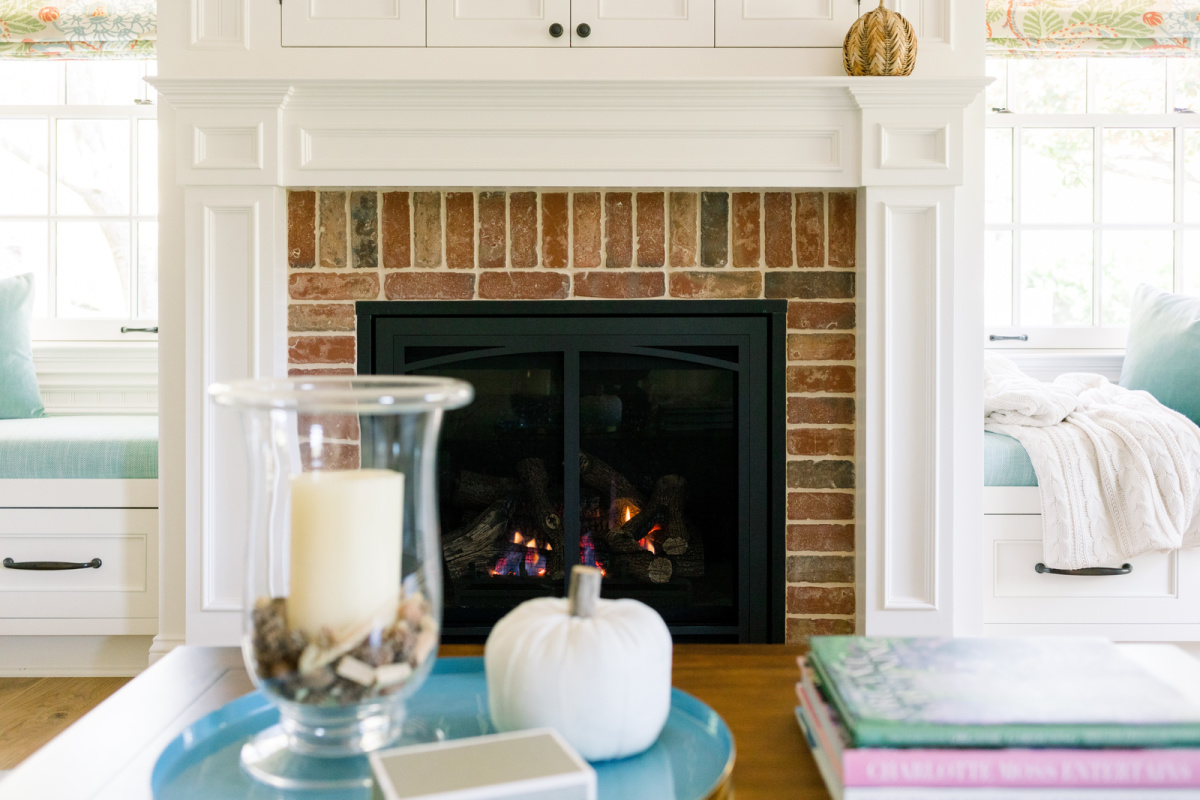 Fireplace mantle and coffee table decorated for fall