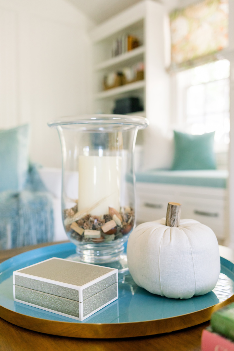 Coffee table fall vignette and window seat