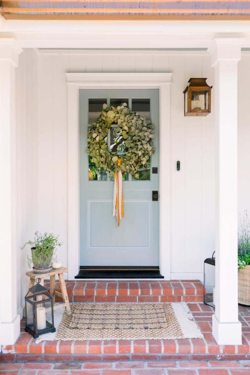 Blue Dutch Door with eucalyptus wreath and fall decor