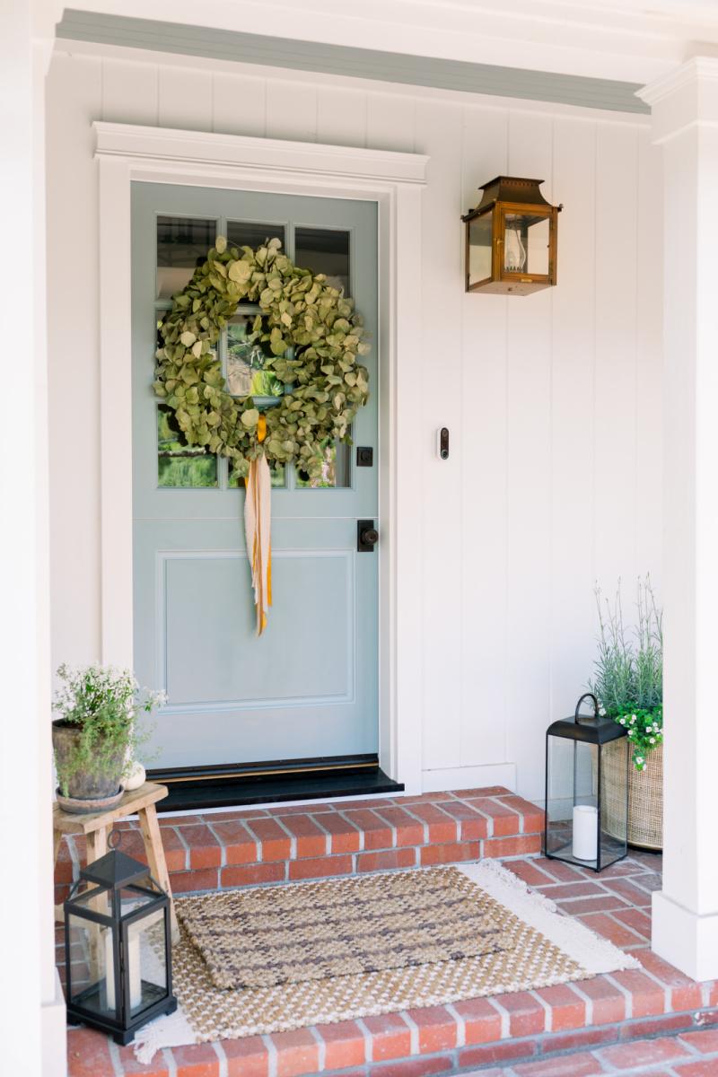 Blue dutch door with eucalyptus wreath