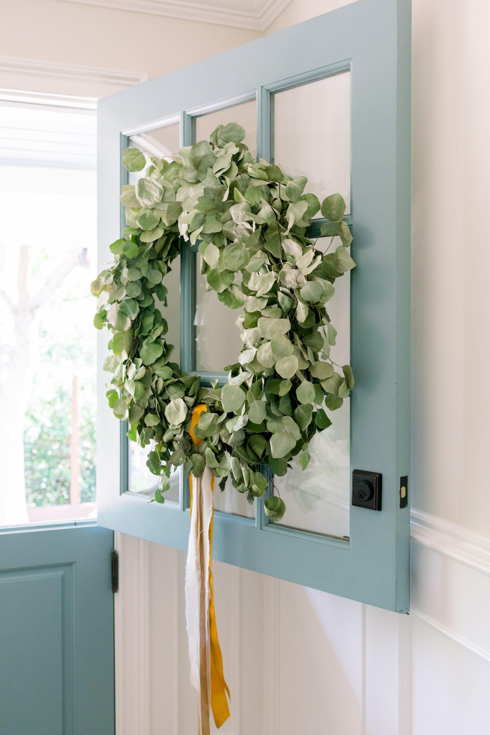 Eucalyptus wreath on blue dutch door